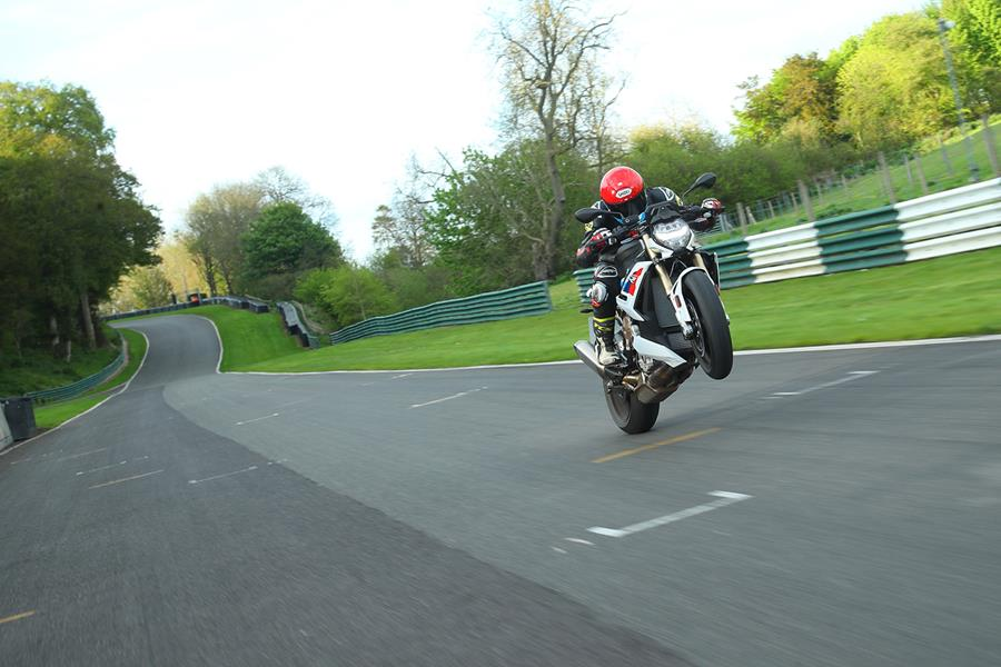 Pulling a wheelie on the BMW S1000R at Cadwell Park