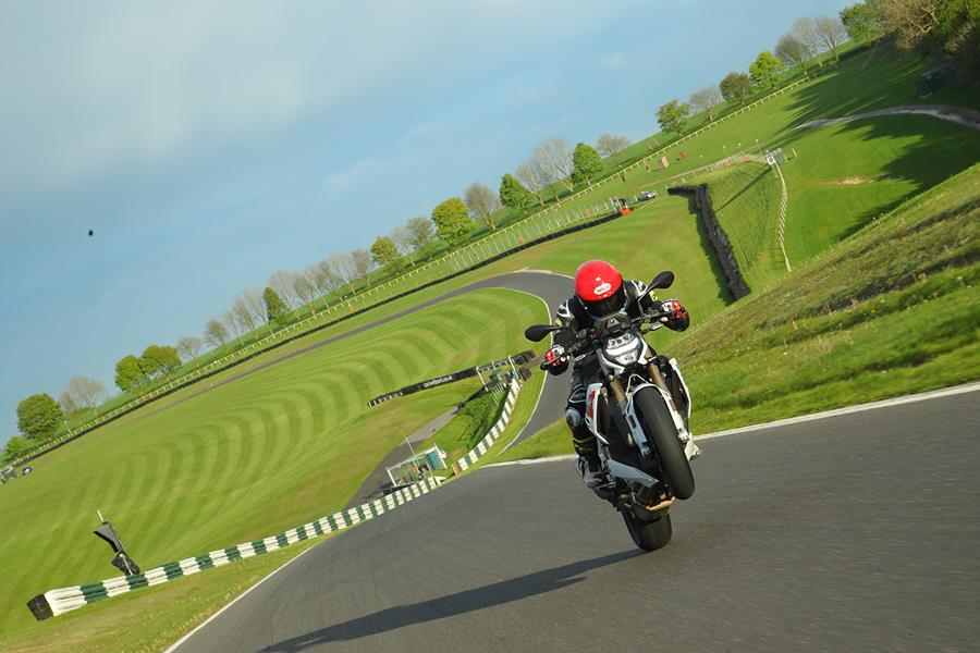 Popping a wheelie at Cadwell Park on the BMW S1000R