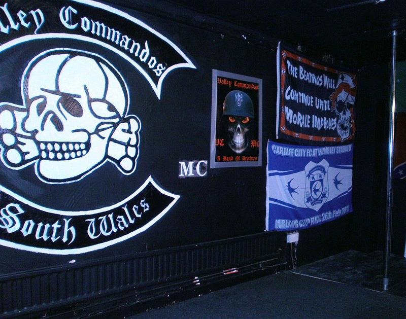 Mock KKK lynching in front of motorcycle club's crest