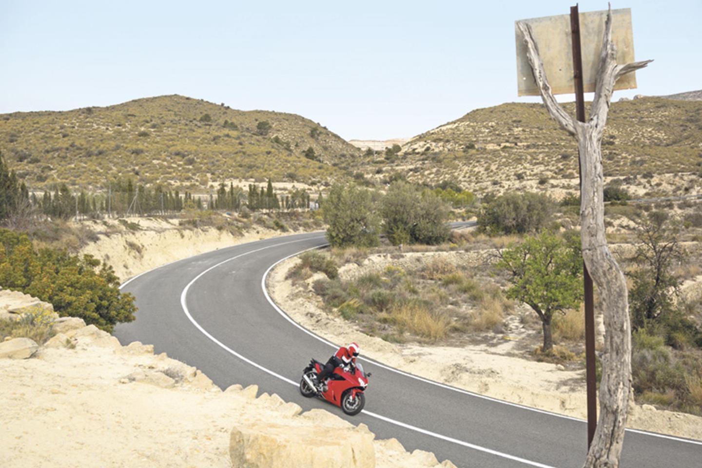 Honda VFR 800 VTEC ridden quickly around a lovely mountain corner