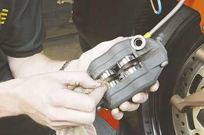Motorcycle Caliper Piston Exposed